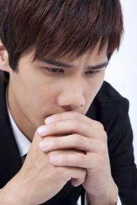 Young man praying for healing