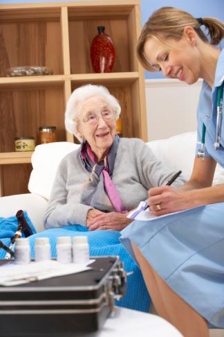 UK nurse visiting senior woman at home